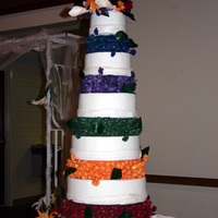 Colorful Wedding Cake  Wedding cake I made for my brothers wedding. Each bridesmaid wore a different colored dress, hence all the colorful flowers. I made over a...
