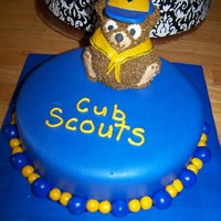 Cub Scout Bear Cake I used a mini-teddy bear cake pan for the top. The hat and bandana are made fondant. The base cake is covered in fondant. This was such an...