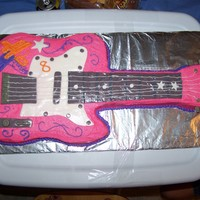 Hannah Montana Guitar Made this cake for my daughter. She wants to learn the guitar and she loves Hannah so this was perfect. I used fondant for the decorations...