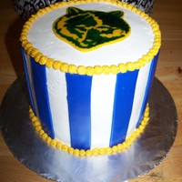 Cub Scout Made this for the cub scout blue and gold cake auction. Used edible marker to make the wolf head on fondant.