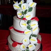 Calla Lily Wedding Cake My very first wedding cake, and very first time I made gumpaste flowers. Butter cream with strawberry and vanilla cake. The calla lilys are...