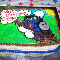 Thomas The Train Chocolate cake with FBCT. I made the face out of MMF. Made this for my nephew. He loved It.