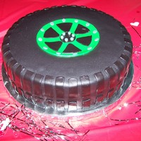Tire Cake Groom workes at a tire center, so we surprised him with a tire cake. Chocolate cake covered in fondant.