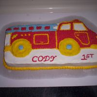 Fire Truck  This cake was made for my nephew for his first birthday. I made it with buttercream icing. It matched his theme perfectly. I also made an...