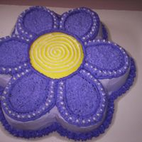 Purple Daisy Cake This cake I made for a co-workers little girl's 2nd birthday. She wanted a purple flower. I think it turned out great.