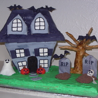 Halloween Haunted House Cake   Entire haunted house and ground made with cake. Dirt is grated chocolate and everything else is made with fondant.
