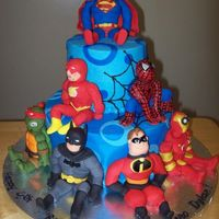 Super Heroes Birthday Cake. The Heroes were hand molded out of fondant. The cake was iced with butter cream with fondant details. Thanks for looking!