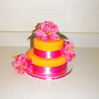 Pink/orange Bridal Shower Cake For a Bride who is getting married somewhere tropical, her colours are pink and orange.