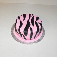 Pink Zebra Smash Cake This was made for a smash cake photo session (proffesional pictures). The cake itself is dyed pink, and the middle is hollowed out and...