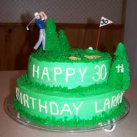 Golf Chocolate and white cake iced with buttercream, decorated with plastic little golfer and golf balls