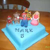 Super Mario Birthday Cake Gumpaste figures on fondant cake