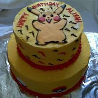 "Pokemon Pokemon cake 9 and 6"" tiered cake frosted in buttercream. Fondant picachu and pokeballs."