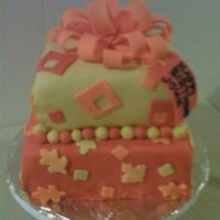 "Fall Presents 8"" and 6"" square cakes covered in fondant with fondant bow. Fall inspired colors."