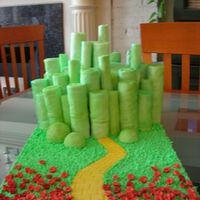 Joels_Cake.jpg My husband loves The Wizard of OZ so this birthday I made him the emerald city. The base was a round lemon cake covered in green fondant....
