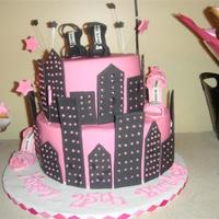 Pink Black City Cake Pink and black city cake with some gum paste Manolo's. Some matching cupcakes and NFSC's