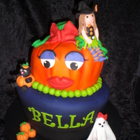Cute Halloween Topsy turvy Halloween birthday cake for a 4 year old little girl. So fun to make!