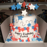 35Th 4Th Of July Birthday 2 tier fondant , almond flavor cake mix and almond flavor icicng with splash of almond and whisky water splash.