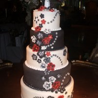 Black And White Fondant With Edible Diamonds THE CAKE WAS MADE ALL IN FONDANT WITH EDIBLE FLOWERS AND DIAMONDS .
