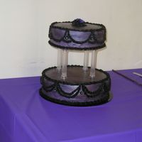Purple & Black Wedding Cake This was my first wedding cake. It was for a renaissance(?)/pirate themed wedding(long story there).