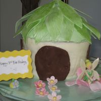 Tinkerbell Cake   This was made using the Wilton 3D large cupcake tin. I used gumpaste for the decorations.