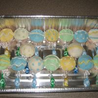 Baby Shower Rattle Cupcakes   These are some baby rattle cupcakes that I made for a baby shower using BC and lollipops.