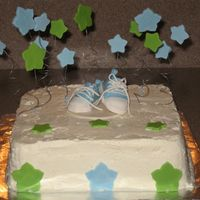 Baby Shower Cake With Converse Shoes  This is a cake with gumpaste decorations that I made for a baby shower. I used the Converse shoes template that Stellastarchild posted....