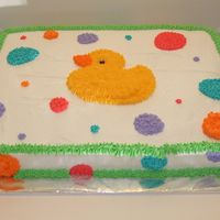 Rubber Ducky Baby Shower Cake I made this cake for my sister's baby shower. She wanted a cute rubber ducky cake with no writing. It is decorated in buttercream.