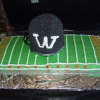 Football Field And 3D Helmet Cake The field is made from 2 sheet cakes put together and iced with buttercream. The helmet is 5 or 6 round layers stacked and then carved some...