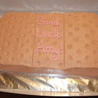 Band-Aid Cake Cake was for our school nurse. Cut in the shape of a band-aid and decorated with buttercream icing. For the indentations of the band-aid I...