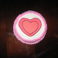 "Small Hearts  This is a small 6"" round cake for the 1 year old birthday girl to have her own cake to play in. Used cookie cutters for the heart..."