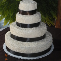 Round Wedding Cake Simple round wedding cake is what the bride wanted. Chocolate chip cake with off white colored buttercream icing. Covered with cornelli...
