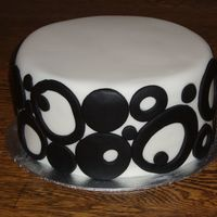 Black Circles On White This is a cake I made for a friend's black tie wine tasting fundraiser. It was delicious - chocolate with vanilla buttercream. I...