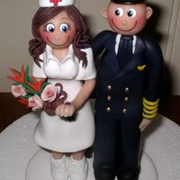 Pilot & Nurse Wedding Cake Topper I miss posting photos of my work because I now make my figurines from Fimo & not gum paste (which I used for 20 years until I...