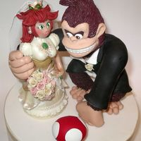 Donkey Kong & Princess Peach I had just finished making this wedding cake topper for a couple of computer game nerds, LOL. The bride found out she was pregnant at the...