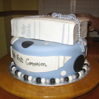 First Communion Cake Two tier cake with fondant covered Bible and fondant Rosary.