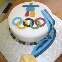 2010 Olympic Cake vanilla cake with fondant Inukshuk, rings, and gold medal