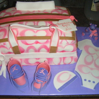 Coach Diaper Bag Coach onsie, baby hat, Jordans sneakers, and a teddy! Lemon cake on top, Chocolate on bottom