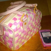 Pink Lv Speedy Purse Louis Vuitton cake and blackberry,pink and white cake, filled with freshed strawberries