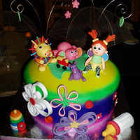 Lamaze Toys Christening Cake   Colorful christening cake with Lamaze toys inspired gum paste figures