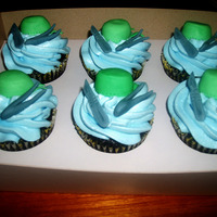 Surgeon Cupcakes Cupcakes topped with surgeon's cap, scalpel, and forceps
