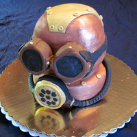 "Steampunk Mask Cake is four 6"" layers of vegan vanilla cake filled with vegan ""butter""cream and hand carved and decorated. It is completely..."