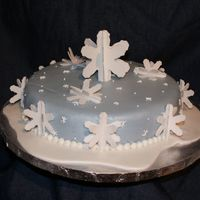 Snowflake Paradise This is fondant covered with fondant snowflakes.