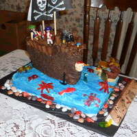 Pirate Ship  My version of a pirate ship . I made this for my grandson who was turning 3. The cake is a yellow cake with buttercreme icing,Pirate face...