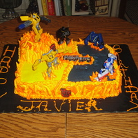 Transformers   Butter sheet cake with buttercreme icing.The flames are buttercreme and the tranformers are toys.