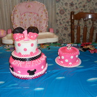 Minnie Mouse And Smash Cake   yellow cake with buttercreme icing and fondant accents. Minnie Mouse is a toy