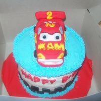 Lightening Mcqueen Smash Cake   Friend brought a picture of this cake and wanted me to try and make it. Car is rkt