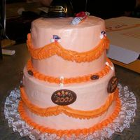 Grad Cake First time doing swags. Yellow cake with buttercream. The grad's school colors were black and orange. The decorations are plastic (on...