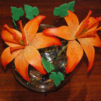 Mother's Day 2010 Two gumpaste tiger lilies with mini gumpaste ivy leaves in a glass bowl.