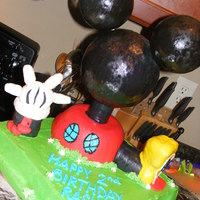 "Mickey Mouse Clubhouse Cake 2   This is my 2nd Mickey Mouse Clubhouse Cake. Head is styrofoam, ""body"" is cake, shoe and glove balloon are RKT."