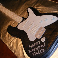 Electric Guitar Cake  This was my first attempt at a guitar cake. Over all, I think it turned out pretty well. This cake was for a 10 yr old boy's birthday...
